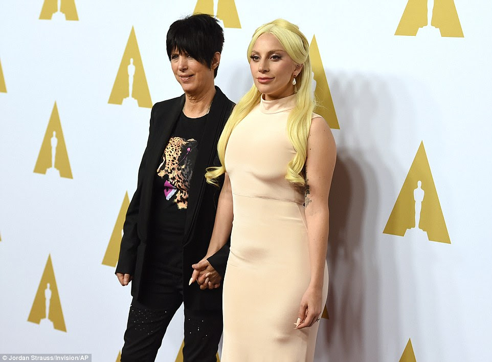 Hand in hand again: The musicians looked closer than ever as they posed against the Oscar backdrop
