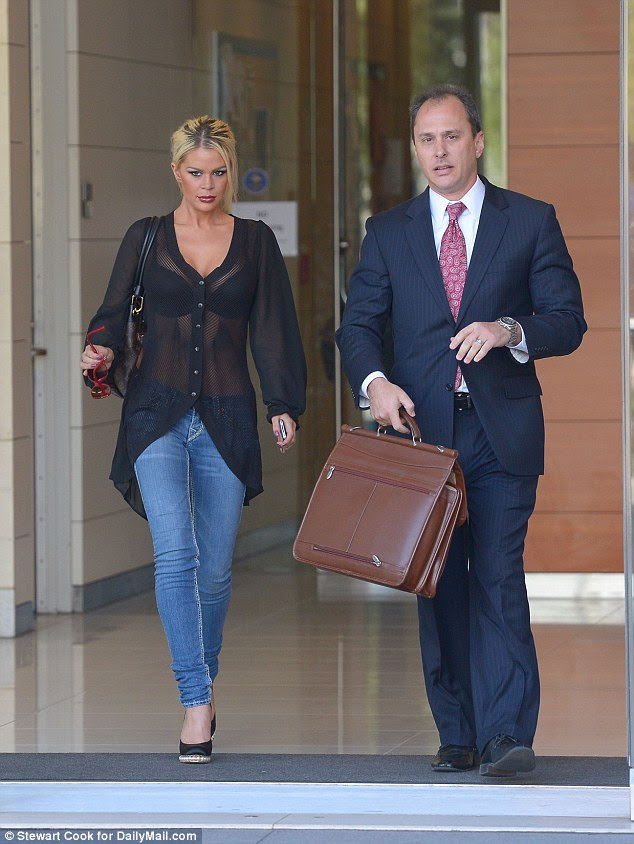 Filing: Chloe Goins with attorney Spencer Kulvin as they leave polce headquarters in Los Angeles after a two-hour meeting with detectives investigating Bill Cosby