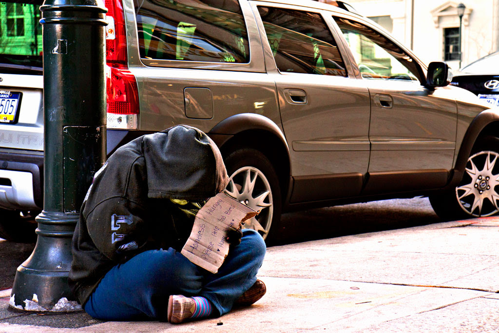 Young-beggar-with-head-down-on-11-23-12--Center-City