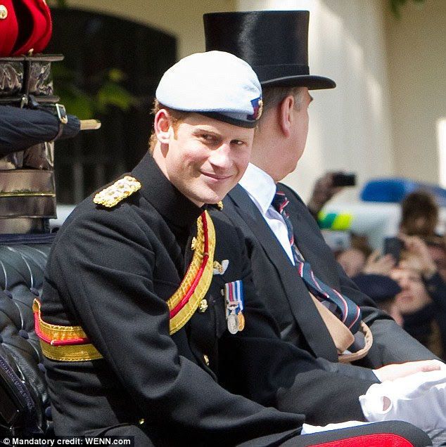 Cheeky smirk: Prince Harry sat opposite Kate in the coach on the way to the ceremony