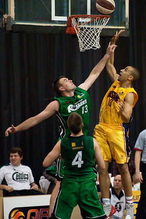 Nicolas Masunda, Scott McGregor - QBL Quarter Final Basketball: Gold Coast Rollers v Brisbane Capitals; Carrara, Gold Coast, Queensland, Australia. Photos by Des Thureson:  http://disci.smugmug.com.