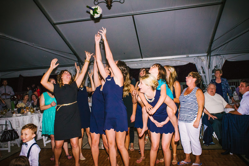 Morgan & John's fun outdoor tent reception on Point Patio at Eagle Ridge Resort near Galena, IL– Wedding photographer; Ryan Davis Photography – Rockford, Illinois.