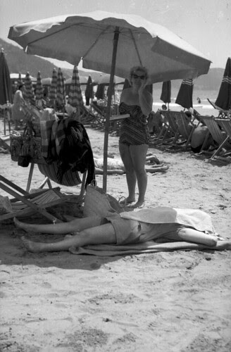 Beach Set asleep in the shade woman with book