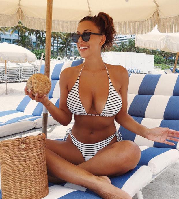 Devin Brugman flaunts her mind Bulging  in minuscule bikini as she hit the Miami beach.