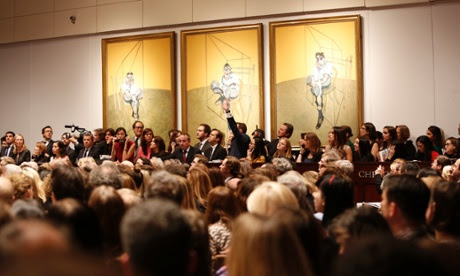 "Bidding during the auction for the 1969 painting by Francis Bacon in New York. ""Three Studies of Lucian Freud"" was sold at Christie's postwar and contemporary art sale for over $142 million in New York, a record for most expensive artwork ever sold at auction."