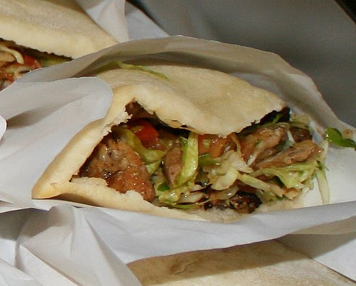 Chicken shawarma - grilled chicken, mixed vegetables, tahini sauce in pita pocket