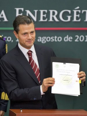 Mexico's President Enrique Pena Nieto shows to the …