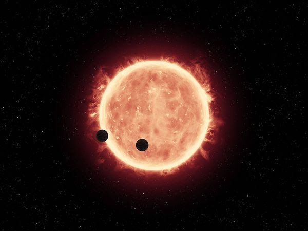 An artist's concept of potentially rocky exoplanets TRAPPIST-1b and TRAPPIST-1c orbiting their parent star.