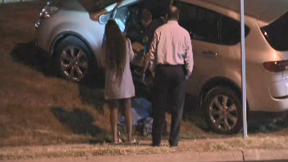 A mother shot a man in the face after the suspect jumped into her car while her two kids were sitting in the vehicle, police said.