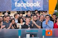In an image released by Facebook, founder Mark Zuckerberg (C) speaks from Facebook headquarters at Menlo Park, California, as he remotely rings the bell to open the Nasdaq on May 18, 2012. Facebook shares leapt some 12 percent in opening trade Friday, then pared their gains, as the wildly popular social network made a splash in its market debut.