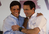 Opposition politicians Leopoldo Lopez, left, and Henrique Capriles Radonski embraces during press conference in Caracas, Venezuela, Tuesday Jan. 24, 2012. Lopez bowed out of Venezuela's presidential race on Tuesday, saying he will support front-runner Capriles. The announcement gives a significant boost to Capriles, who has a commanding lead in the polls ahead of the Feb. 12 opposition primary, which will choose a single challenger to face President Hugo Chavez in the Oct. 7 presidential election. (AP Photo/Ariana Cubillos)