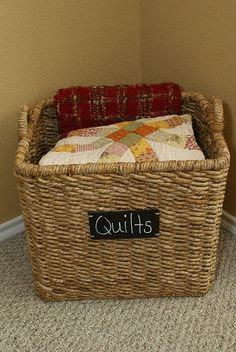 Beautiful quilt storage display in basket.
