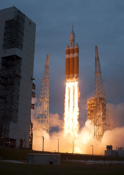 A Delta IV Heavy rocket carrying the Orion spacecraft lifts off from Cape Canaveral Air Force Station in Florida...beginning Exploration Flight Test (EFT)-1 on December 5, 2014.