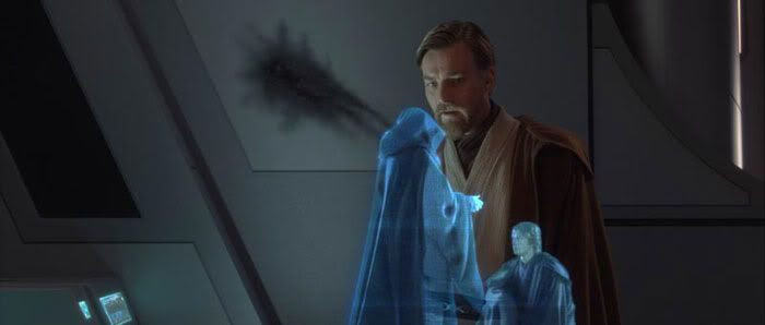 Obi-Wan Kenobi watches a hologram of Anakin Skywalker being knighted as Darth Vader by Darth Sidious.