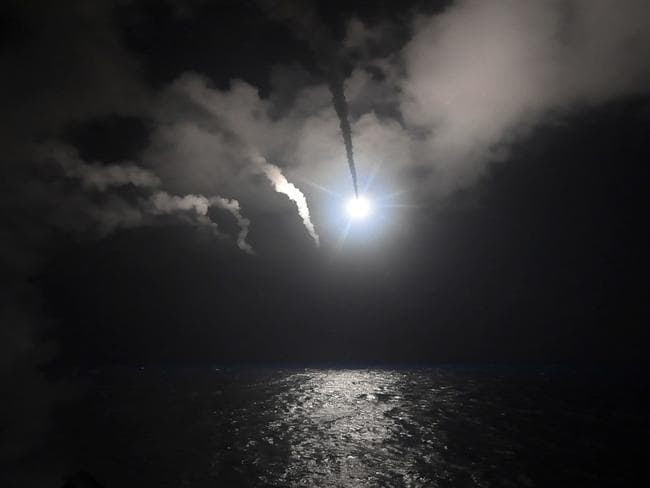 The guided-missile destroyer USS Porter launches a tomahawk land attack missile in the Mediterranean Sea. Picture: AP