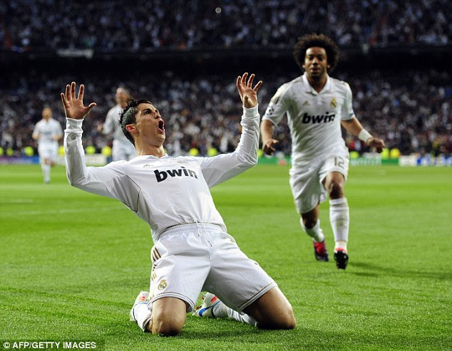 Milking the applause: Ronaldo celebrates after scoring his second goal of the night