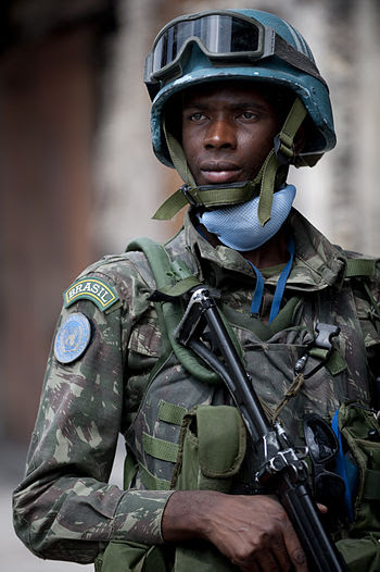 A Brazilian soldier stands security in Port-au...
