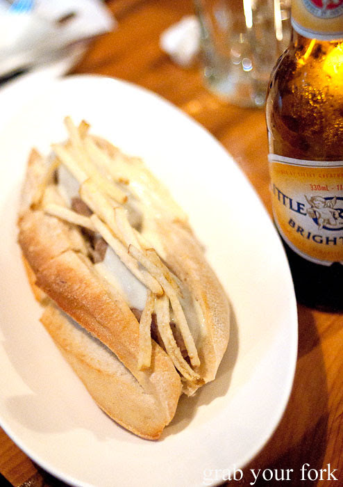 pork hot dog with truffle sauce at assembly bar