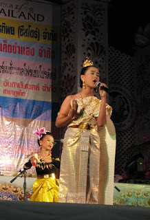 Another young singer with dancers