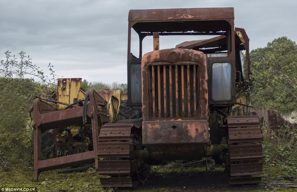 Mothballed: This truck, fitted with caterpillar tracks, stands rusting next to a pile of other equipment at RAF Folkingham