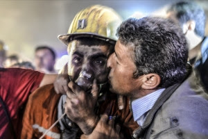 "TOPSHOTS A man kisses his son, rescued of the mine, on May 13, 2014 after an explosion in a coal mine in Manisa. At least 157 miners were killed in collapsed coal mine in the western Turkish city of Manisa. ""At least 200-300 workers were working in the mine when an electric fault caused an explosion,"" the mayor of Soma, a district of Manisa, told private NTV television. AFP PHOTO/BULENT KILICBULENT KILIC/AFP/Getty Images"