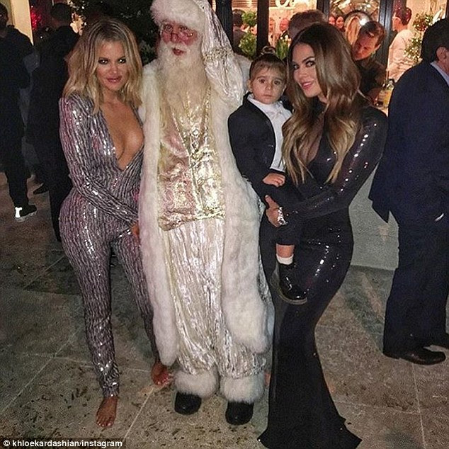No shoes, no problem: The looker went barefoot in this snap with a female pal, Penelope and Santa