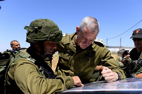 IDF Chief of Staff Benny Gantz reviewing maps on the Golan Heights.