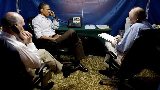 President Barack Obama is briefed on the uprising in Libya during a conference call inside a secure tent setup near his hotel suite in Rio de Janeiro, March 20, 2011.