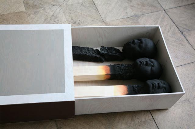 Matchstickmen: Burnt Matches Resembling Charred Human Heads by Wolfgang Stiller  wood sculpture matches