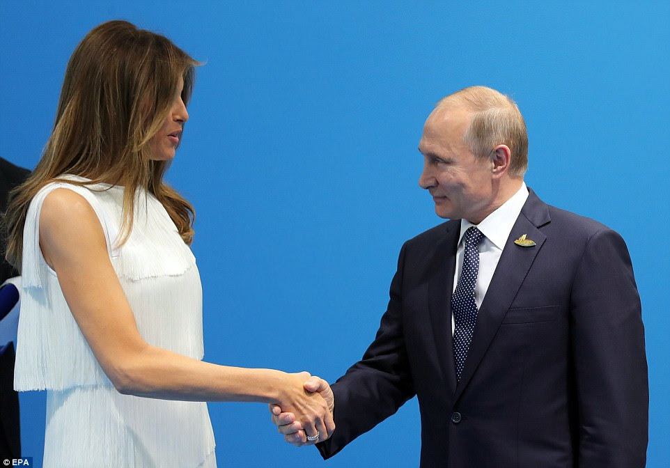 Earlier on Friday, Melania Trump (left) greeted Russian President Vladimir Putin (right) with a handshake