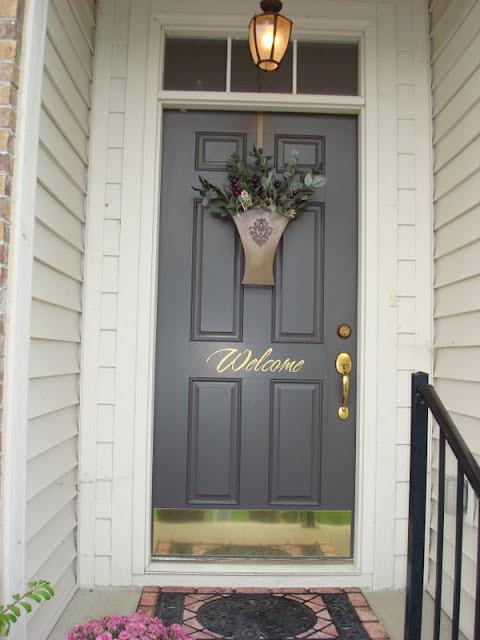Welcome sign brown door