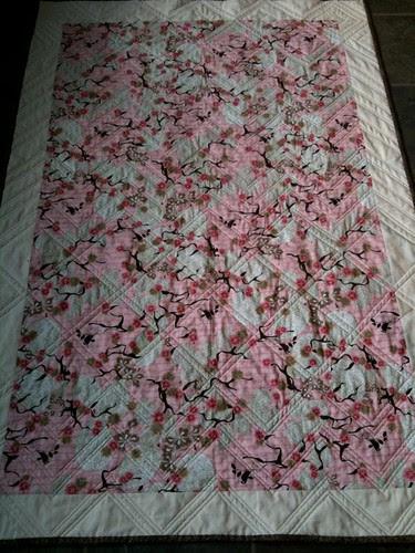 back, pink zig zag quilt