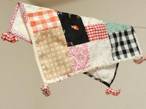 Sarubobo holds patchwork cloth