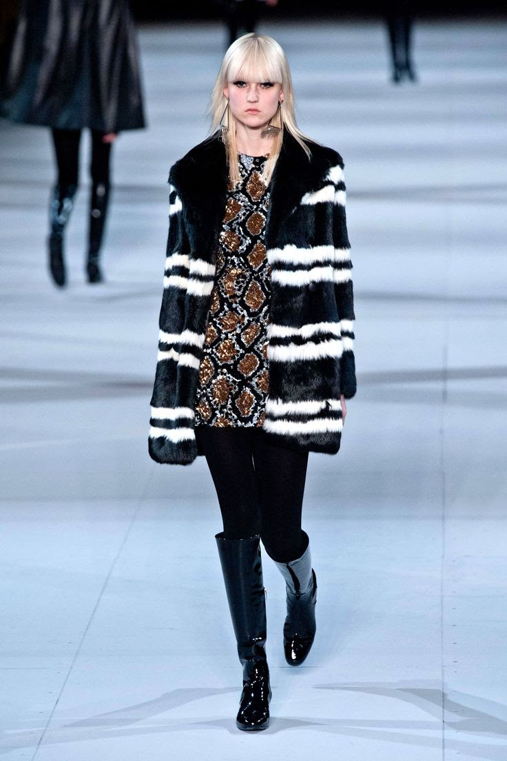 Saint Laurent. Fall 2014. Striped fur jacket, beaded short dress, shiny knee-high black boots – for a night out!