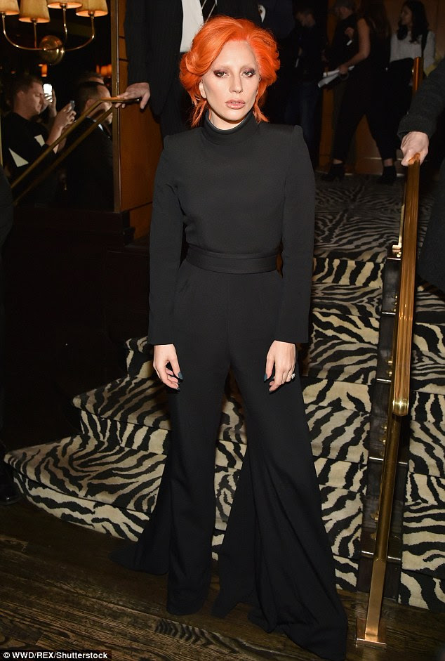 Her style: The chic black turtleneck jumpsuit featured slouchy bell-bottom style trousers and a belted waistline