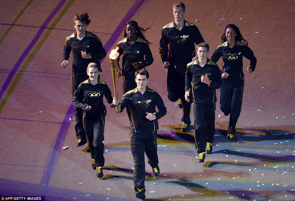 Young athletes carried the Olympic flame around the stadium, a symbol of the Games' legacy