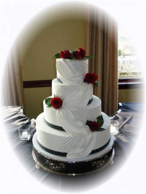 elegant white wedding cake with red flowers (1 comment)