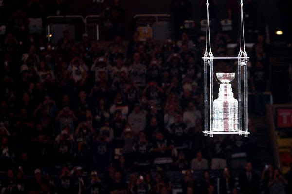 The crowd watches as the Stanley Cup is lowered towards the ice during the L.A. Kings' opening game ceremony at STAPLES Center, on October 8, 2014.