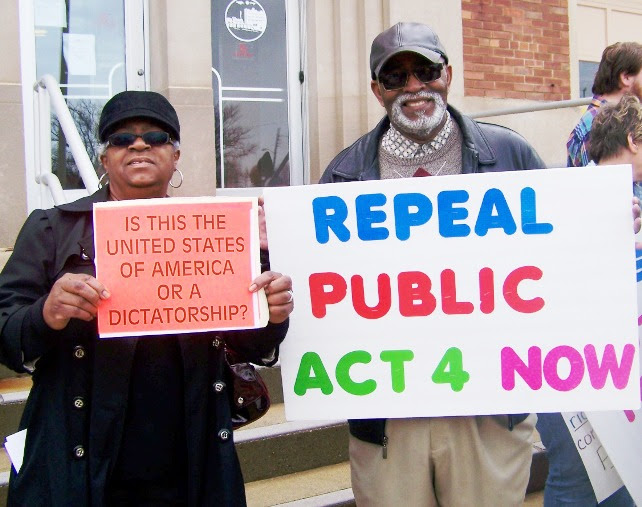 Detroiter Wanda Hill and Benton Harbor resident George Moon at first rally against PA 4 in 2011, on Benton Harbor city hall steps. PA 4 was indeed repealed, only to be replaced by PA 436.