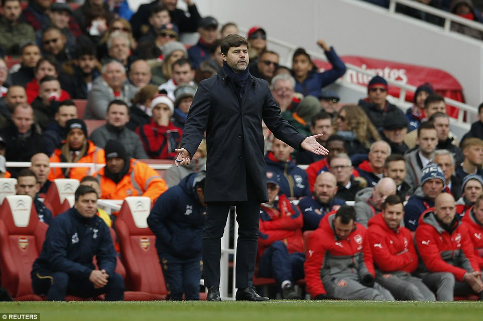 Tottenham boss Mauricio Pochettino looks frustrated as he watches proceedings from the away  technical area