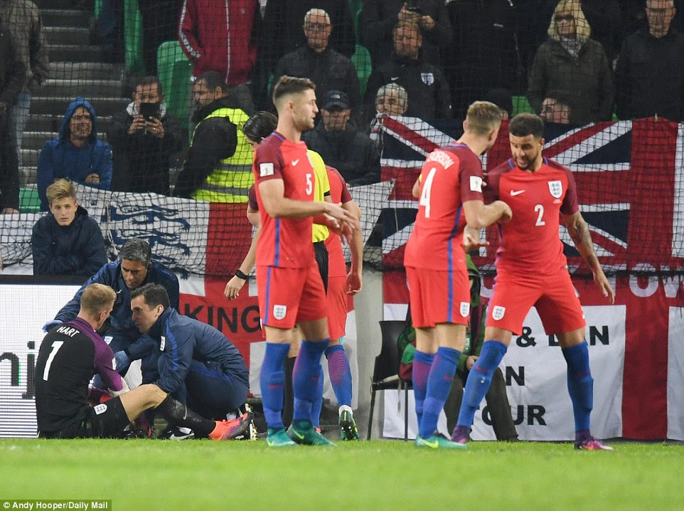 Hart (left) took a couple of minutes out for medical assistance but was able to carry on following his brilliant double save