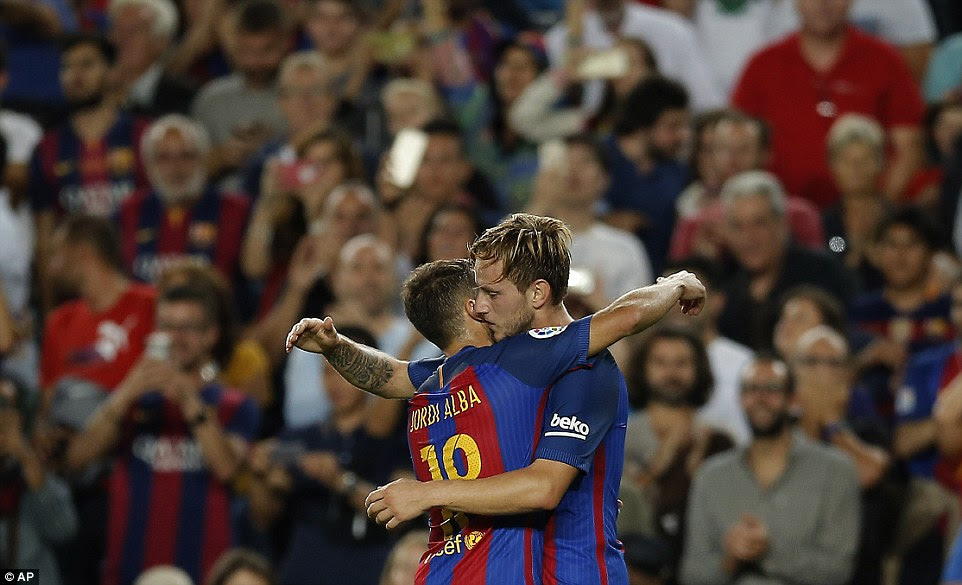 The Croatian ace is congratulated by Jordi Alba after scoring the opening goal of the game in the first half at the Nou Camp
