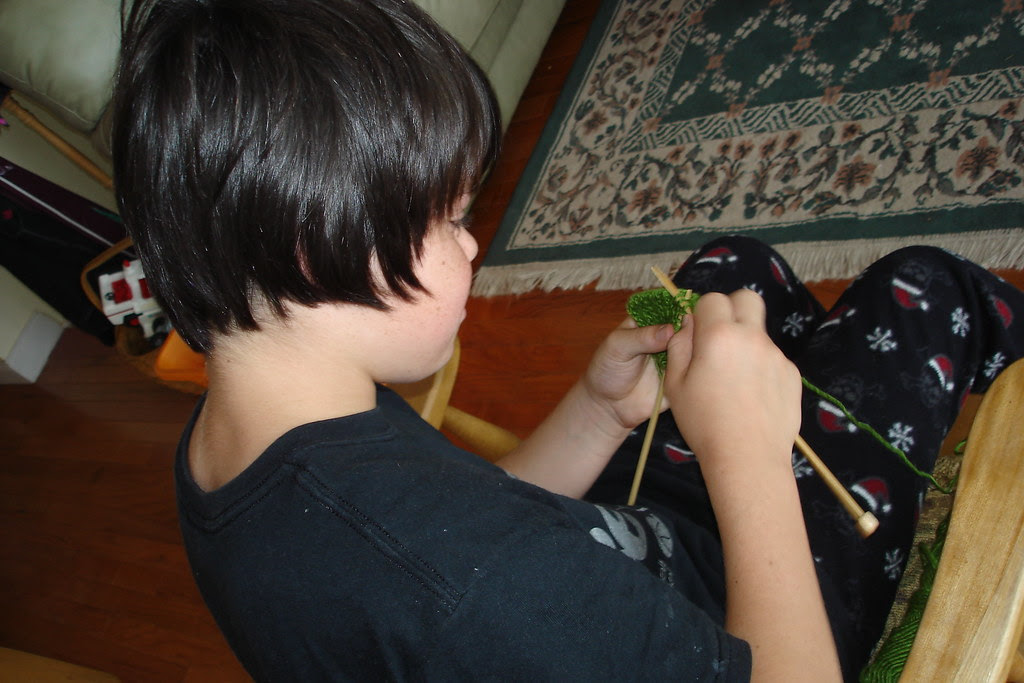 My nephew, knitting...