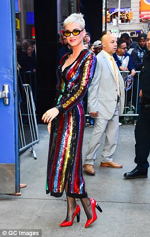 Sexy:The singer, 32, slipped her enviably leggy figure into the colourful gown