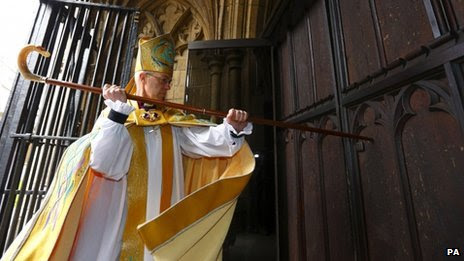 The Archbishop of Canterbury knocks to enter cathedral