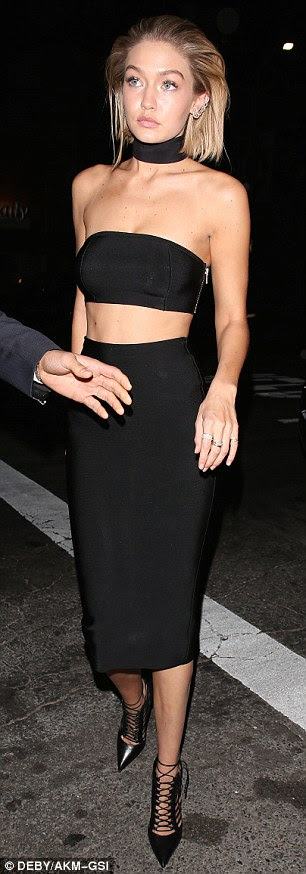 Lean and slender: The striking model looked good from every angle as she made her way to the bash