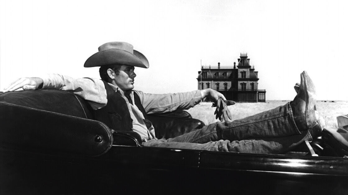 James Dean on the set of the 1956 film Giant, which was filmed on the Ryan Ranch, west of the town of Marfa. The skeleton of the mansion in the background still stands on the ranch today.
