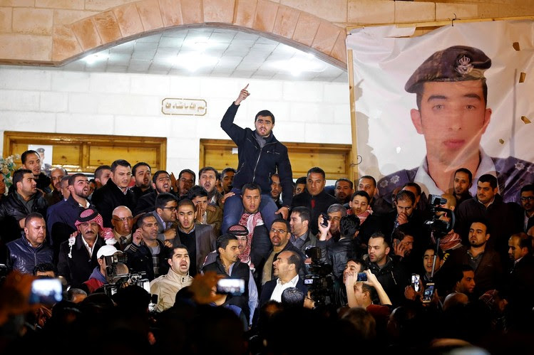 Supporters and family of Jordanian pilot First Lt. Muath al-Kasasbeh in Amman on Tuesday express anger of his reported killing by Islamic State.