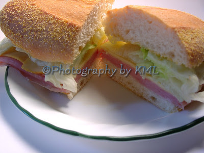 ham sandwich on a small plate