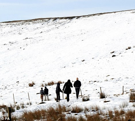 Hardy: Ramblers walk in the snow near Pately Bridge, Yorkshire, as forecasters warn of plummeting temperatures to come